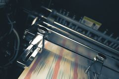 Printing press with blurred belt during printing process stock photos