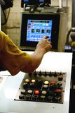 Printing Press Controls. A hand adjusting the color levels on a computer screen at the printing press controls Stock Image