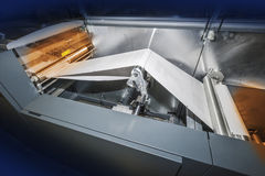 Printing press. Modern ink jet printing press with paper coming off rollers Stock Images