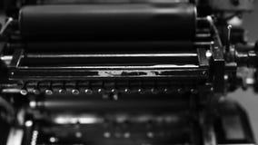 Printing Press in Print Shop in Black and White stock video