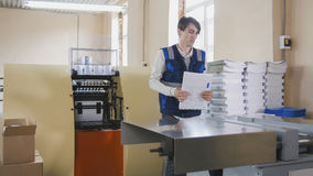 Printing process - feeding sheets of paper, polygraph industry, wide angle Stock Image