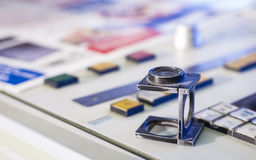 Printing process with magnifying glass Royalty Free Stock Photos