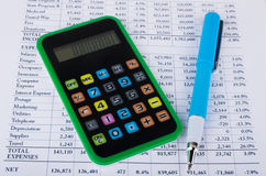 Printout, calculator and pen Royalty Free Stock Images
