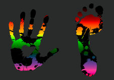 Prints. Illustration of colored hand and leg prints on gray background Royalty Free Stock Photo