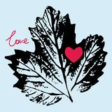 Prints black leaf on a blue background, love.  Royalty Free Stock Photos