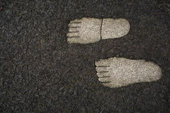 Prints of feet from granite Royalty Free Stock Photos