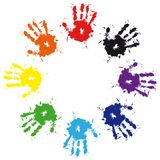 Prints of hands from ink colorful splash Stock Photos