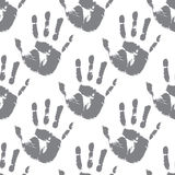 Prints of hands, seamless pattern. Seamless vector pattern of prints of hands Stock Images