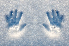 Prints of hands on snow, a matrix. The young girl played and has left traces of the palms in snow Royalty Free Stock Image