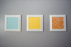 Prints on a Wall 3. Three framed prints hanging on a wall royalty free stock photos