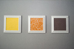 Prints on a Wall 2. Three framed prints hanging on a gray wall royalty free stock images