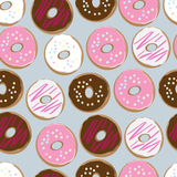 Seamless background of assorted doughnuts. PrintSeamless background pattern of assorted doughnuts, or donuts, with chocolate, white and pink iced ones covered in Stock Image