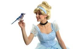 Prinzessin, die einen Vogel hält Stockbild