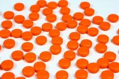 Priorità bassa arancione delle pillole Fotografie Stock Libere da Diritti