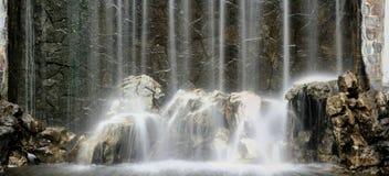 Priorità bassa artificiale della cascata Fotografie Stock