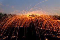 Priorità bassa astratta con gli sparklers arancioni Immagini Stock