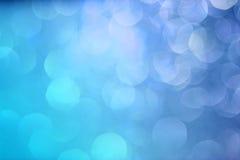 Priorità bassa blu del bokeh Indicatore luminoso di natale blu Nuovo Year& x27; bokeh di s con la pendenza Immagine Stock