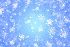 Priorità bassa blu di natale con i fiocchi di neve Immagine Stock