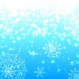 Priorità bassa brillante blu di natale dei fiocchi di neve Immagini Stock Libere da Diritti