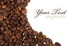 Priorità bassa con i chicchi di caffè Fotografie Stock Libere da Diritti
