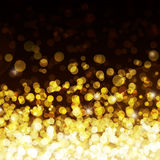 Priorità bassa defocused degli indicatori luminosi dell'oro Fotografie Stock Libere da Diritti