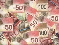 Priorità bassa dei canadesi cinquanta e cento fatture del dollaro Immagine Stock