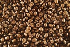 Priorità bassa dei fagioli del caffè espresso Fotografia Stock
