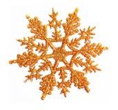 Priorità bassa dei fiocchi di neve dell'oro Fotografia Stock