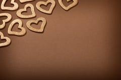 Priorità bassa del biglietto di S. Valentino - cuori dorati Fotografia Stock