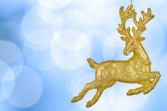 Priorità bassa del bokeh di natale con la renna dorata Immagini Stock