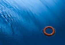 Priorità bassa dell'acqua del conservatore dell'anello di Lifebuoy Fotografie Stock Libere da Diritti