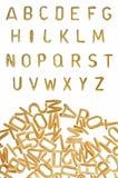 Priorità bassa dell'alimento della fonte tipografica della pasta di alfabeto Fotografia Stock