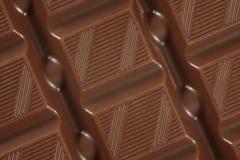 Priorità bassa della barra di cioccolato Fotografie Stock