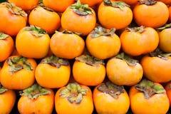 Priorità bassa della frutta del cachi Fotografie Stock