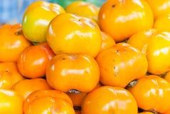 Priorità bassa della frutta del cachi. Fotografia Stock