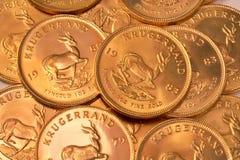 Priorità bassa della moneta di oro Fotografie Stock