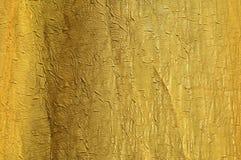 Priorità bassa della seta dell'oro Fotografia Stock Libera da Diritti