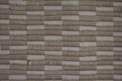 Priorità bassa della tessile beige e tan tessuta Fotografia Stock