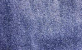 Priorità bassa delle blue jeans Fotografia Stock