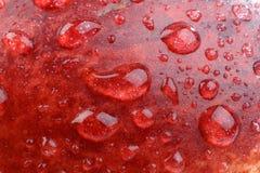 Priorità bassa delle goccioline di acqua lucide su frutta Immagine Stock Libera da Diritti