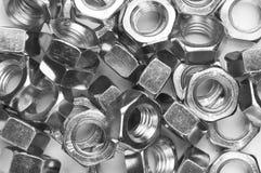 Priorità bassa delle noci del metallo Fotografia Stock