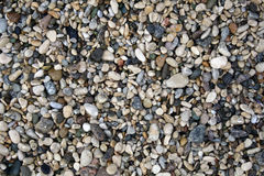 Priorità bassa delle pietre del mare Fotografia Stock