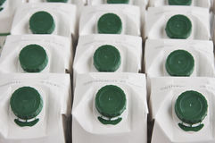 Priorità bassa delle scatole del latte. Fotografie Stock Libere da Diritti