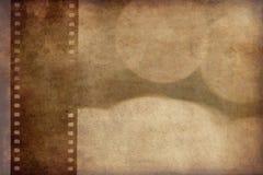 Priorità bassa di Grunge con la striscia della pellicola Fotografie Stock Libere da Diritti