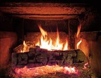 Priorità bassa di legno del fuoco della stufa Fotografia Stock