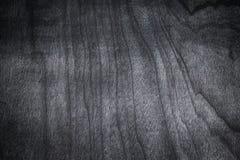 Priorità bassa di legno scura di struttura Struttura dello scrittorio nero della tavola fotografia stock