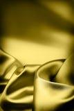 Priorità bassa di lusso della seta dell'oro Fotografia Stock Libera da Diritti