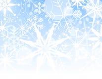 Priorità bassa di sbiadisc del fiocco di neve Fotografia Stock