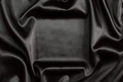 Priorità bassa di seta nera della tessile Fotografie Stock Libere da Diritti