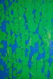 Priorità bassa di struttura di Grunge Fondo di legno con pittura dei colori differenti Fondo immagine stock